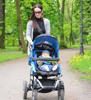 Mom exercising walking with baby pram