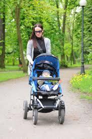Mom exercising walking with baby pram